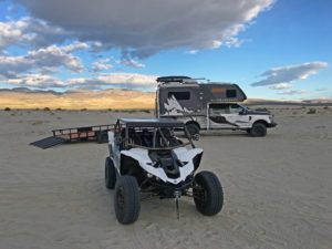 "Taking our custom Yamaha YXZ1000R on an epic adventure with lance Camper's ""Altimeter"" 855S Truck Camper and Ford's F350 Super Duty Platinum."